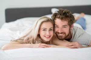 Loving couple lying in bed